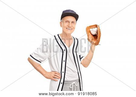 Senior man in a white baseball jersey holding a baseball and looking at the camera isolated on white background