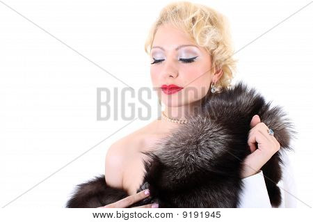 Blondie Woman With Fur Collar Dreaming. Monroe Imitation