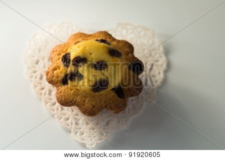 Aerial View Delicious Cupcake With Raisins On White Doily Closeup