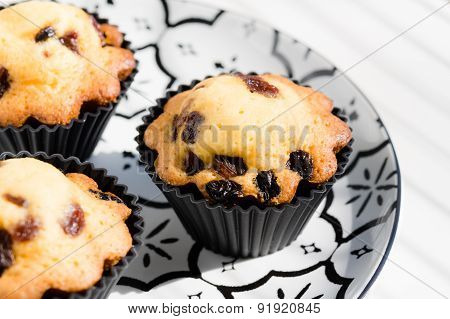 Aerial View Delicious Cupcakes With Raisins On Vintage Pattern Plate