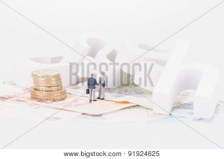 Miniature Businessmen And Cash Letters