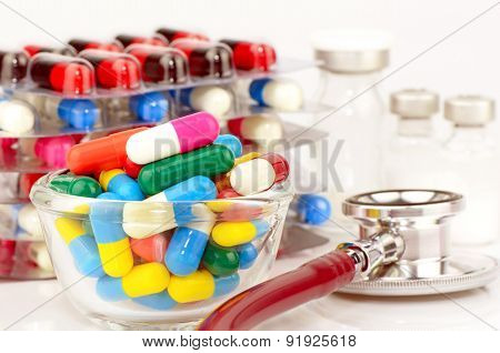 Colorful Of Oral Medications, Sterile Vials And Stethoscope On White Background.