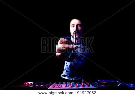 Disc Jockey Mixing Music And Smokes Joint