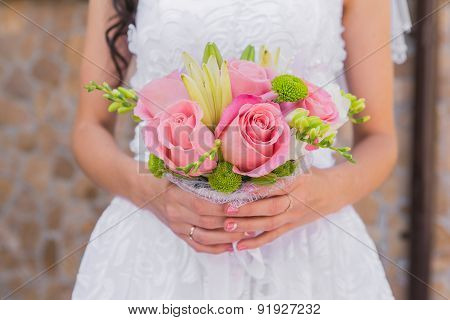 Wedding bouquet of pink roses and leaves