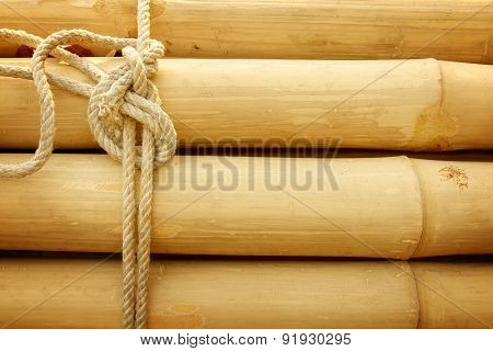 Bamboo Panel With A Rope Tied.