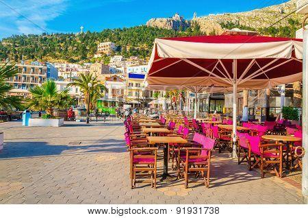 Purple chairs and umbrella in Greek restaurant