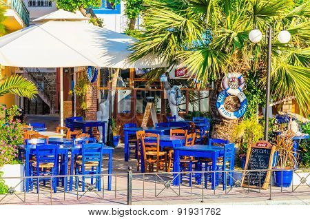 Blue wooden tables in Greek restaurant