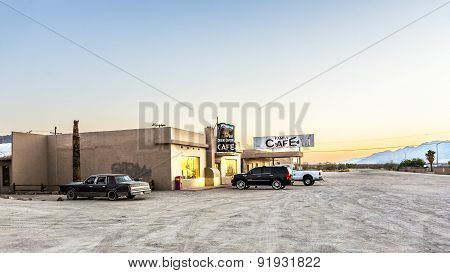 Car Park In Front Of Cafe In Late Afternoon At Desert Center, Usa