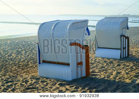 Two Roofed Wicker Beach Chairs At The Baltic Sea