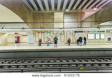 People Wait In The  Famous Oriente Metro Station For The Train
