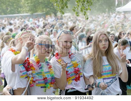 Four Happy Young Girls Before The Start In The Color Run