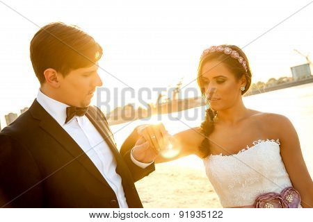Wedding Couple Looking At Engagement Ring