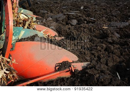 Plough On A Tractor Working In The Field