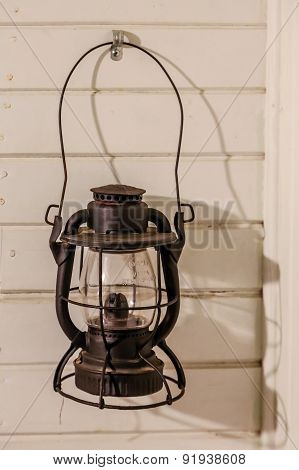 Old Oil Lamp On Wood Wall
