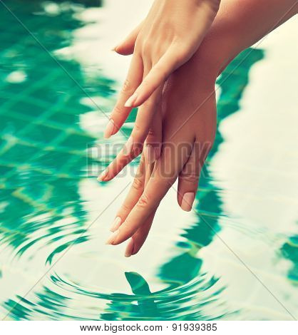 Graceful gentle hands , hand care . Beautiful hands are washed in water