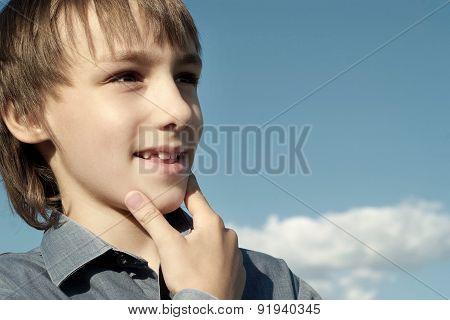 Teen under a blue sky