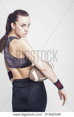 Sport And Fitness Concept: Seriously Looking Professional Female Soccer Player With Standard Ball. L