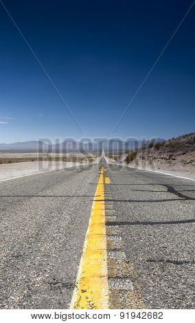 Long Highway Under The Summer Sun Across Death Valley National Park