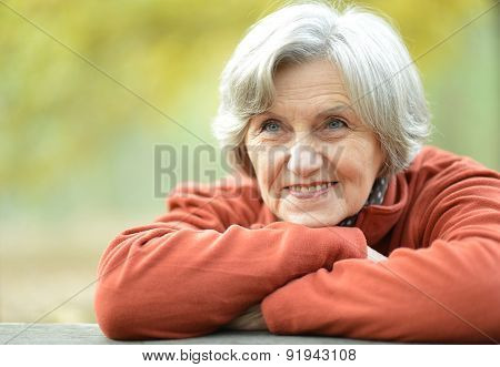 happy old woman posing at nature