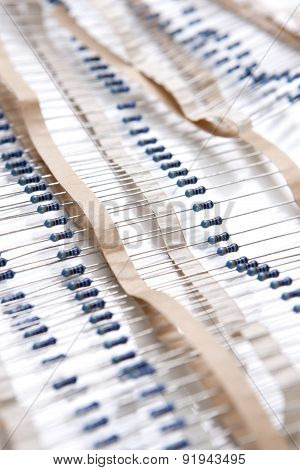 Many Resistors On Tape. Isolated Over White.