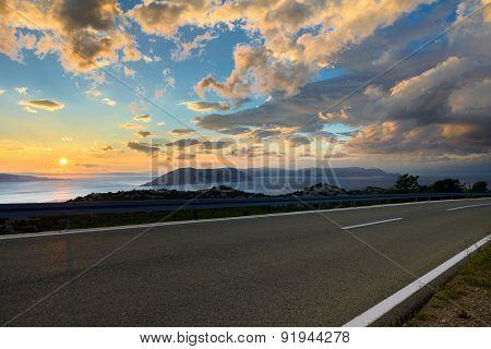 Beautiful coastal road at sunset