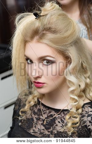 woman hairdresser do hairstyle girl in beauty salon
