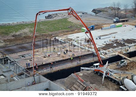Pouring Concrete On Construction Side.