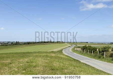 Winding road on a field