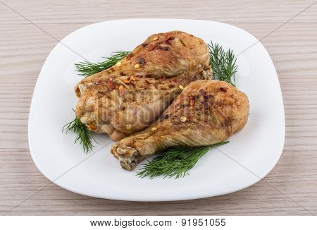 Three Fried Chicken Legs Sprinkled Pepper With Dill