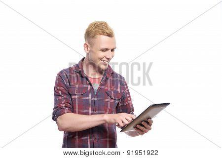Handsome man working on tablet