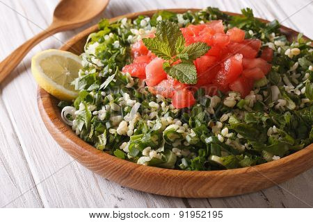 Dietary Tabbouleh Salad Closeup In A Wooden Bowl. Horizontal