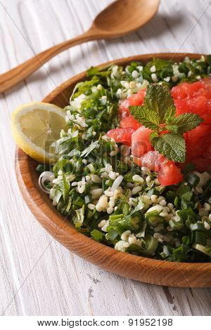 Dietary Tabbouleh Salad Closeup In A Wooden Bowl. Vertical