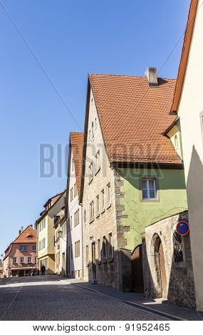 Half Timbered Houses In A Narrow Street  In Rothenburg