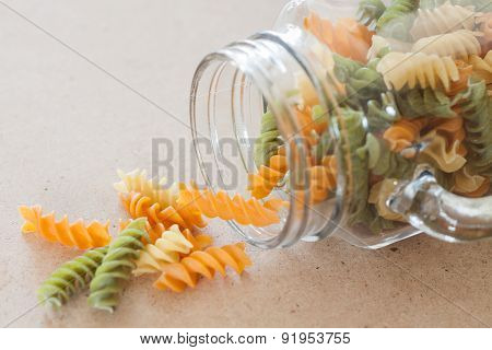 Raw Fusilli Pasta With Glass Bottle