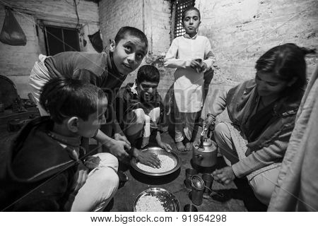 KATHMANDU, NEPAL - CIRCA DEC, 2013: Unknown children during dinner at Jagadguru School. School established at 2013, to let new generation learn Sanskrit and preserve Hindu culture.