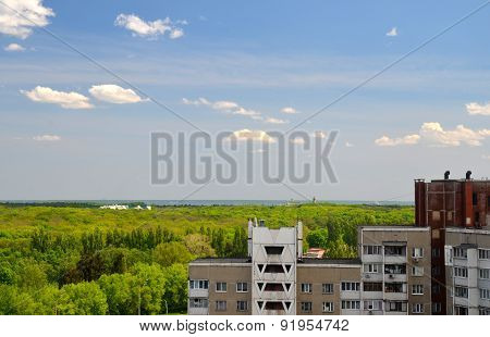 River Skyline, Forest And Apartment Buildings