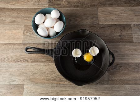 Eggs In Frying Pan.