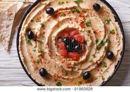 Hummus With Olives Close-up. Horizontal Top View
