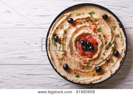 Fresh Hummus With Olives And Tomatoes. Horizontal Top View