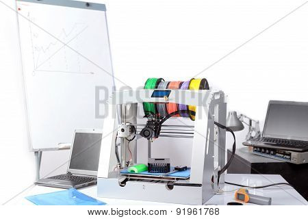 Three-dimensional printer on the table