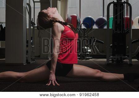 Young Girl Sitting On Gymnastic Splits