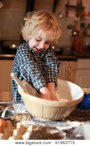 Young Boy Who Is Mixing Flour