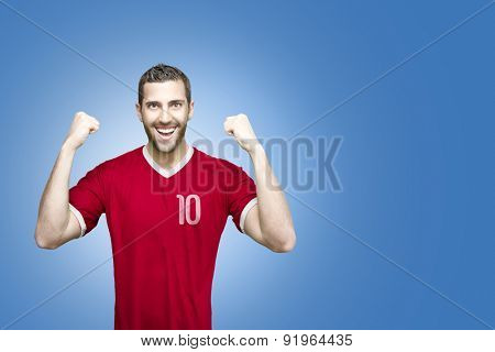 Soccer player on red uniform on blue background