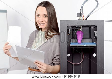 Beautiful girl with three-dimensional printer