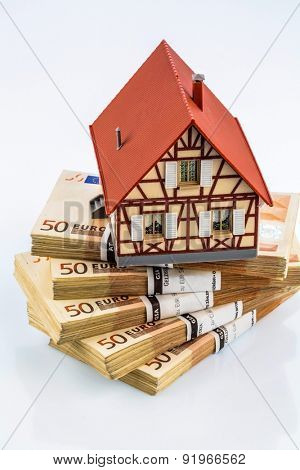 half-timbered house on euro banknotes, symbol photo for home purchase, financing, building society