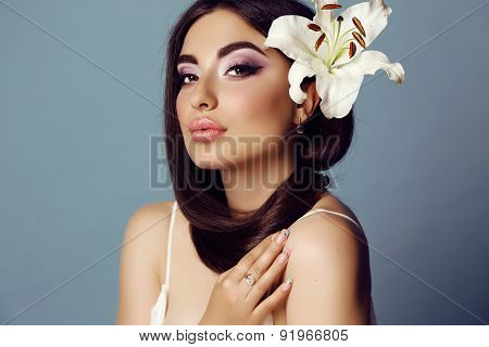 Girl With Dark Hair And Bright Makeup With Accessories