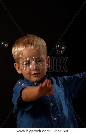 Catching soap bubbles