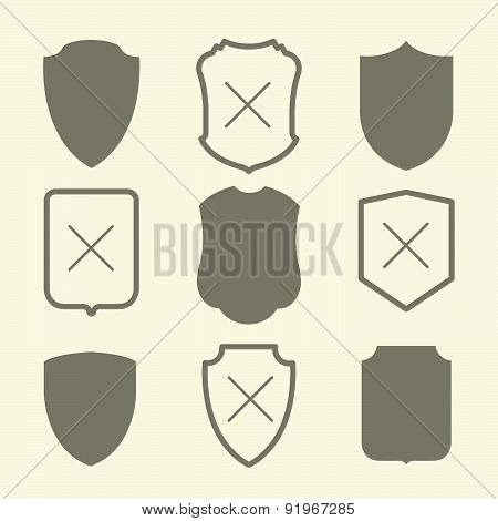 Vector Illustration With Simple Silhouettes Of Shield.