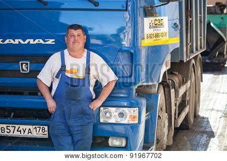 Positive Truck Driver Stands Near His Kamaz