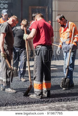 Asphalting In Progress Group Workers With Shovels